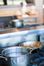 Cooking pots and pans on a gas stove Royalty Free Stock Images