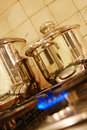 Cooking pots on stove Royalty Free Stock Photo