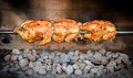 Cooking 3 rotisserie chicken on the grill with Charcoal and Briquettes Royalty Free Stock Photo
