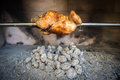 Cooking rotisserie chicken on the grill with charcoal and briquettes in professional steak house or barbecue restaurant Stock Photo