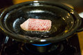 Cooking saga beef steak on hot pan Stock Photography