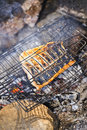 Cooking salmon over camp fire open very shallow depth of field Royalty Free Stock Image