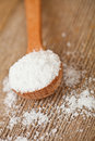 Cooking salt in wooden spoon Royalty Free Stock Photo