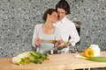 Cooking she smiles at him Royalty Free Stock Photo