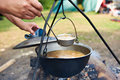 Cooking soup over campfire in hike Royalty Free Stock Photo