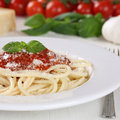 Cooking spaghetti noodles pasta prepared meal with tomato sauce food and basil on plate Royalty Free Stock Photography