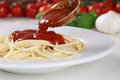 Cooking spaghetti noodles pasta: serving tomato sauce Napoli Royalty Free Stock Photo