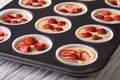 Cooking strawberry muffins in baking dish macro Royalty Free Stock Photo