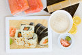 Cooking sushi with tablet rolls on display ingredients Stock Photo