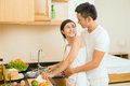 Cooking together image of a young couple standing in the kitchen and embracing Royalty Free Stock Photography