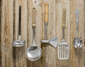 Cooking tools five cookware on a wood plank surface Royalty Free Stock Photo