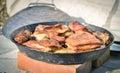 Cooking of traditional balkan turkish bosnian dalmatian meal pek peka in metal pots called sac sach or sache roast pork Stock Photos