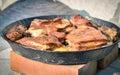 Cooking of traditional balkan turkish bosnian dalmatian meal pek peka in metal pots called sac sach or sache roast pork Stock Image