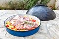 Cooking of traditional balkan turkish bosnian dalmatian meal pek peka in metal pots called sac sach or sache roast pork Royalty Free Stock Photos