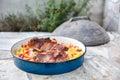 Cooking of traditional balkan turkish bosnian dalmatian meal pek peka in metal pots called sac sach or sache roast pork Stock Photo
