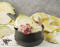Cooking the traditional Norwegian dish of braised cabbage with l Royalty Free Stock Photo