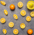 Cooking and vegetarian concept orange juice, hand juicer and oranges granite  rustic background top view close up Royalty Free Stock Photo