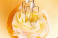 Cooking whisking egg mixer the with a and cream in a bowl Royalty Free Stock Image