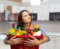 Cooking young girl with a basket full of goods Royalty Free Stock Photo