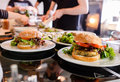 Cooks preparing vegan dishes burgers in a restaurant Stock Images