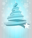 Cool blue christmas tree shape at snowfall Stock Photos