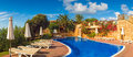 Cool blue summer holiday pool villas and on a hot summers day Stock Photos