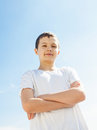 Cool boy portrait of a confident standing outside picture from low angle view Royalty Free Stock Photography