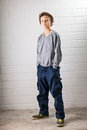 Cool boy a teenage standing hands in his pocket making a confident face and pose Stock Photos