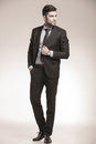 Cool business man looking to his side full body picture in studio Royalty Free Stock Images