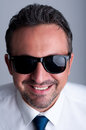 Cool business man wearing shades or sunglasses Royalty Free Stock Photo