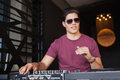 Cool dj in sunglasses working on a sound mixing desk Royalty Free Stock Photo