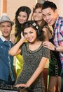 Cool dj vertical portrait of young partying people in the night club Royalty Free Stock Photography