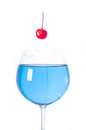 Cool drink blue cocktail and red cherry with lighting and reflection Royalty Free Stock Photos