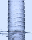 Cool drinking water bottle close up with dew drop Stock Images