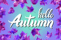 Cool fresh blue Hello Autumn design with elegant white text and bunches of orange fall leaves over a graduated blue background wit