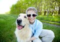 Cool friends portrait of cute lad in sunglasses and his fluffy friend outdoors Royalty Free Stock Images