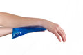 Cool gel pack on a swollen hurting wrist medical concept photo Stock Photo