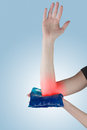 Cool gel pack on a swollen hurting wrist medical concept photo Stock Images
