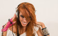 Cool hip hop dancer listening to the music female redhair Stock Photos