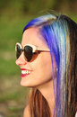 Cool hipster girl portrait of an wearing sun glasses Stock Image