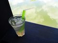 Cool iced lemongrass drink beside resort garden pool a photograph of a glass of light lime green made from lemon grass a popular Stock Image