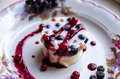 Cool jelly with fresh berries on a light plate decorated with berries and jam close up Royalty Free Stock Photo