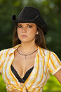Cool looking brunette woman with cowboy hat Stock Image