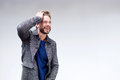 Cool male fashion model with beard smiling Royalty Free Stock Photo