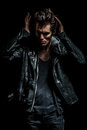 Cool man in leather jacket fixing his hairstyle Royalty Free Stock Photo