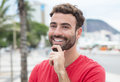 Cool man with red shirt and beard in the city Royalty Free Stock Photo