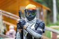 Cool paintball fighter in special armor holding paint handgun. Royalty Free Stock Photo