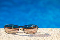 Cool poolside shades with sleek holiday villas reflected in the lenses Royalty Free Stock Photography