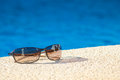 Cool poolside shades with sleek holiday villas reflected in the lenses Stock Image