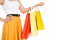 Cool shopping cropped image of a female shopper carrying bags over a white background Royalty Free Stock Photography
